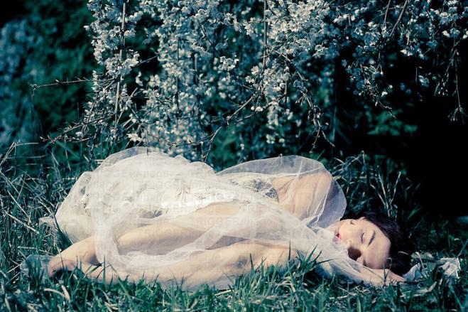 Female youth sleeping outdoors
